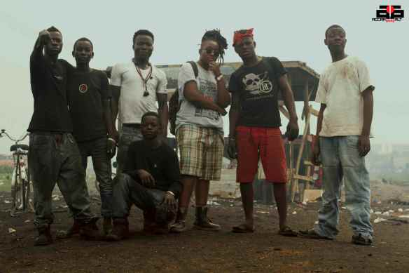 Tawiah hangs out with workers in Agbogbloshie | photo by REDD Kat Pictures [Dec. 2012]