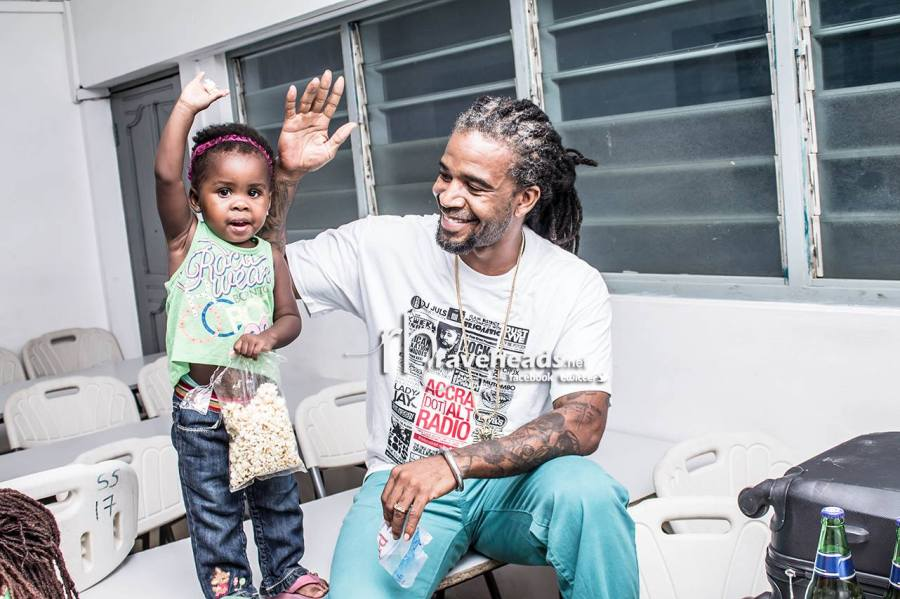 One half of Hola Blak Pow wah rocks his Accra Dot Alt shirt while posing with his grand daughter.