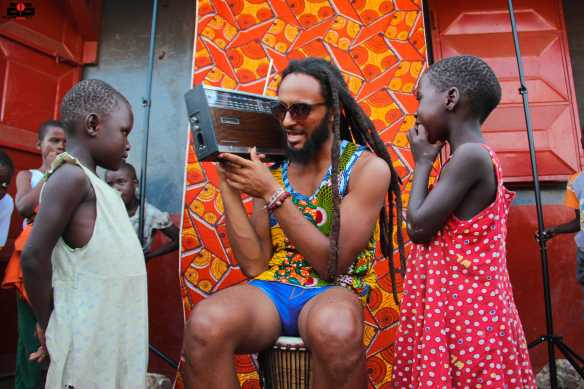 Wanlov teaching James Town kids a thing or two about signaling.